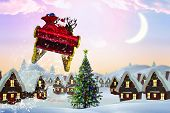 picture of santa sleigh  - Santa flying his sleigh against cute christmas village with tree - JPG