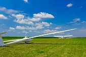 pic of glider  - Sailplane glider airplane wide angle shot on the airfield waiting for take-off.