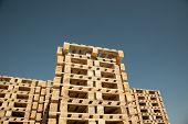 stock photo of wooden pallet  - Low angle view wooden pallets and sky - JPG