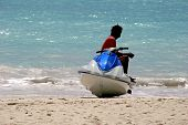 stock photo of whoopees  - a jet ski rider taking a rest - JPG