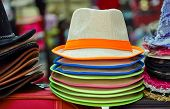 pic of panama hat  - Pile of colorful hats are on sale at the marketplace - JPG