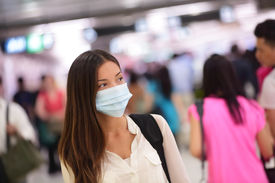 foto of polluted  - Person wearing protective mask against transmissible infectious diseases and as protection against pollution and the flu - JPG