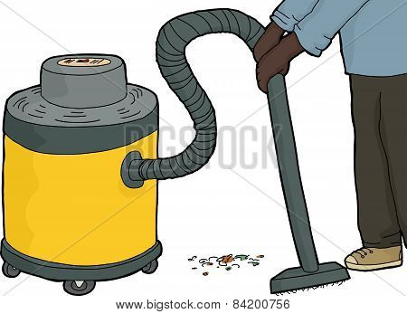 Person Sweeping With Vacuum