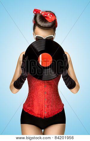 Behind Vinyl.