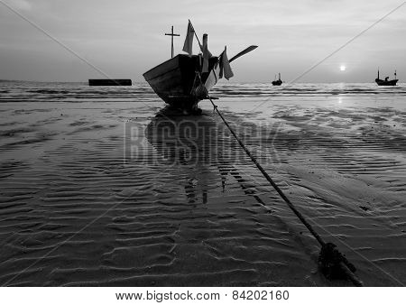 The fishing boat with a beautiful sunset in black and white Thailand