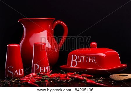 Red Salt-cellar, Pepper-box, Butter And Pitcher Set On Darck Background By Cristina Arpentina