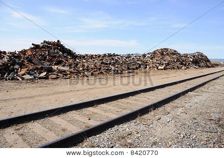 Scrap Metal Pile by Railroad Line in Alaska