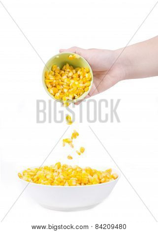 Sweet Corn In White Bowl Ready For Eat With Hand And Spoon