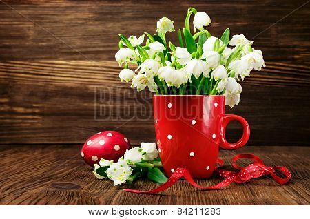 Snowdrops In A Cup With Polka Dot Pattern  And Painted Eggs