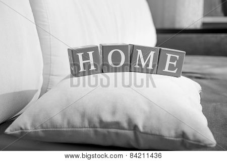 Black And White Photo Of Word Home Spelled On Wooden Cubes