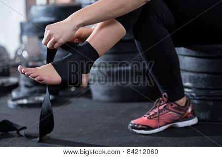 Woman With Gimp On Her Ankle