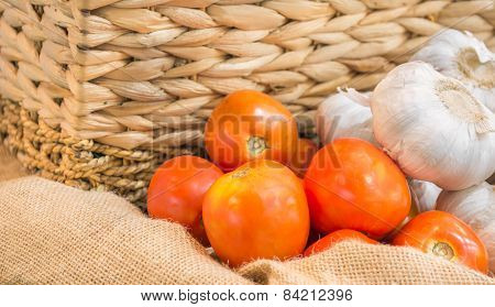 Tomato And Garlic In Sack Bag With Basket For Background Usage Image.