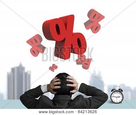 Businessman Hand Holding Head With Red Percentage Signs And Clock