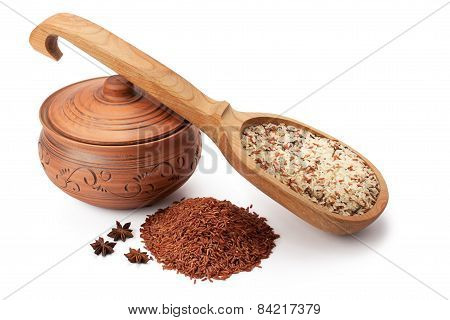 Clay Pot, Wooden Spoon And Wild Rice With Star Anise