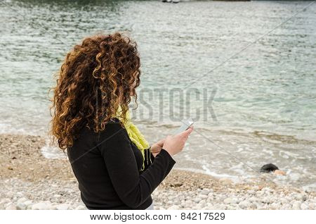 Young Woman, Finds Herself Alone, Taking Advantage Of The Holidays, And Use Smartphone.