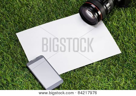 Camera With Mobile Phone And Sheet Of Paper