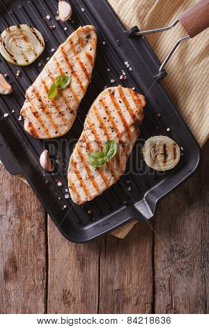 Grilled Chicken Fillet In A Skillet Close-up  Vertical Top View