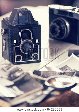 Old cameras and photos, filtered still life
