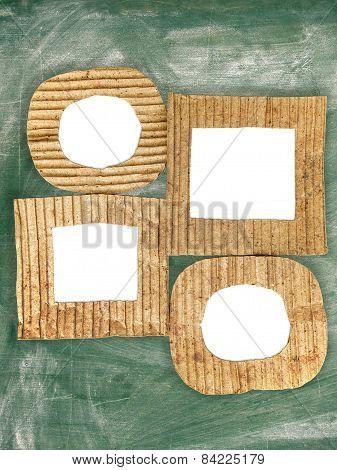 Group Of Blank Cardboard Frames On Grunge Chalkboard