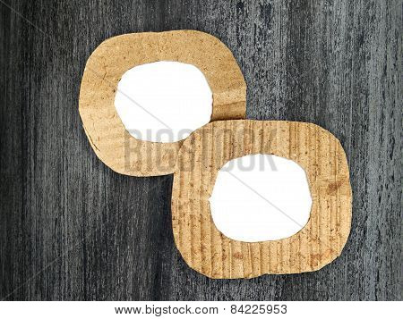 Two Round Blank Cardboard Frames On Grunge Painted Background