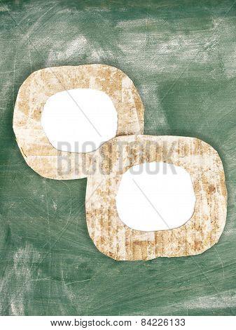 Two Blank Chalk Dirty Painted Cardboard Frames On Grunge Chalkboard