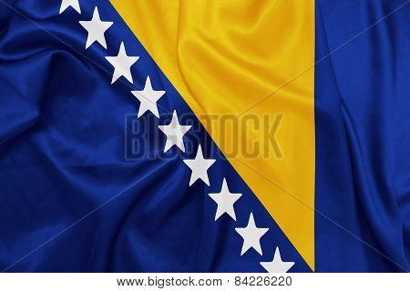 Bosnia and Herzegovina - Waving national flag on silk texture