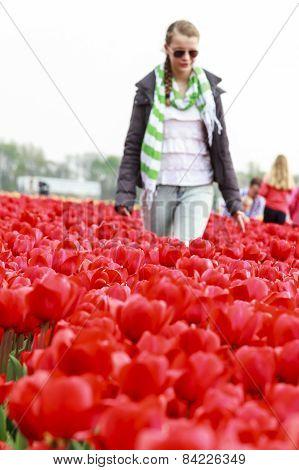 Girl In Red Tulips