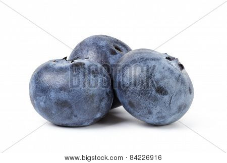 three ripe blueberries