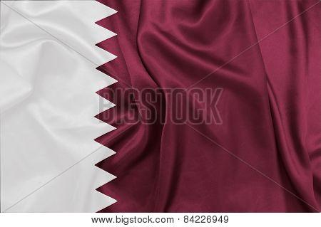 Qatar - Waving national flag on silk texture