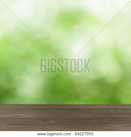 empty wooden table with green summer bokeh background