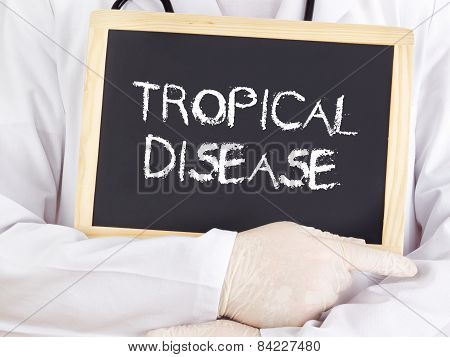 Doctor Shows Information On Blackboard: Tropical Disease