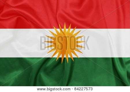 Kurdistan  - Waving national flag on silk texture