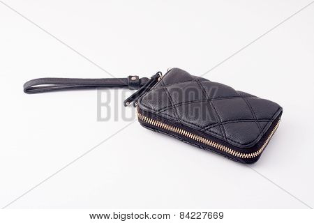 black wallet with gold zipper