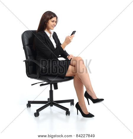 Executive Business Woman Using A Smart Phone Sitting On A Chair