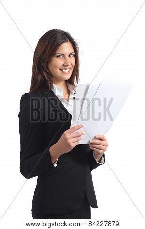 Happy Businesswoman Holding A Report And Looking At Camera