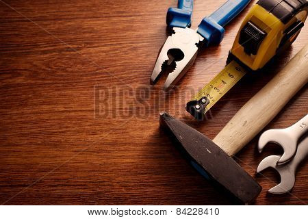 Hand Tools On A Table With Copy Space On Left Side