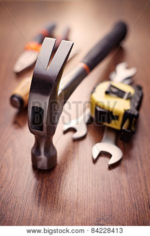 Head Of A Claw Hammer On A Table With Other Tools