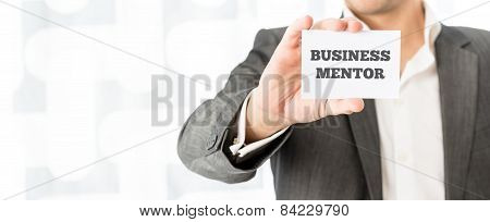 Card With The Words Business Mentor