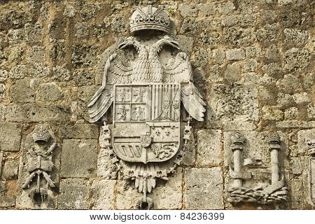 Coat of arms at the exterior wall of the Ozama fortress in Santo Domingo, Dominican Republic.
