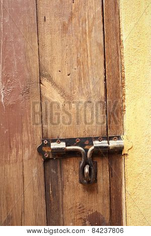 Lock Of The Door Locked With Padlock.