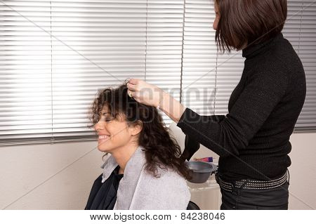 Woman at hair dresser
