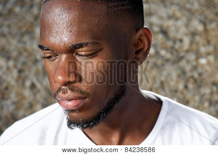 Young Man Looking Away With Sweat Dripping Down Face