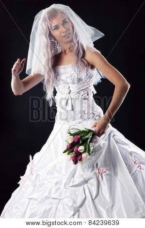 bride doll with a bouquet of tulips