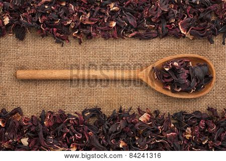 Wooden Spoon With  Dried Hibiscus Lies On  Sackcloth