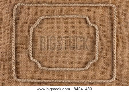 Two Frame Of Rope, Lies On A Background Of Burlap
