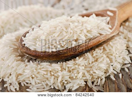 Uncooked Rice In A Wooden  Spoon