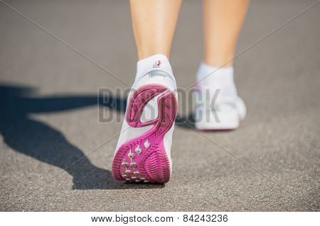 Walking In Sports Shoes.