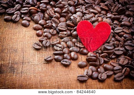 Red Heart And Coffee Beans On Wood Background