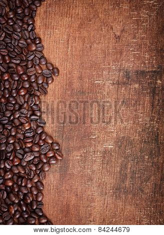 Wood Background With Coffee Beans On It