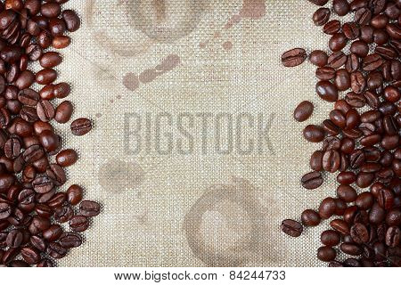 Coffee Beans And Burlap With Coffee Stains And Rough Edges